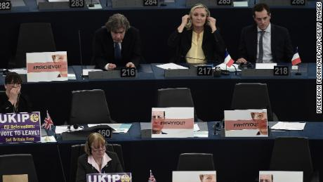 French far-right leader Marine Le Pen (back center) with other French MEPs and UKIP members surrounded by euroskeptic messages.