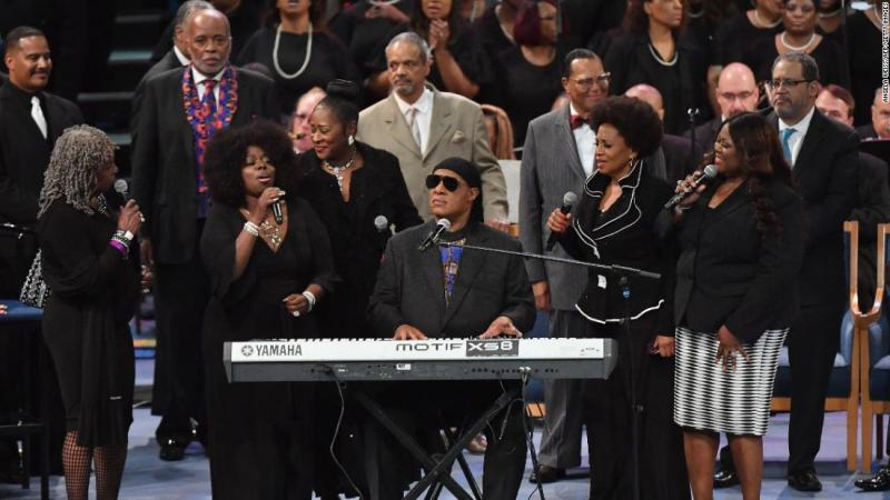 "Stevie Wonder performs at Franklin's funeral on Friday. He began by playing the harmonica before singing, ""I'll Be Loving You Always."""