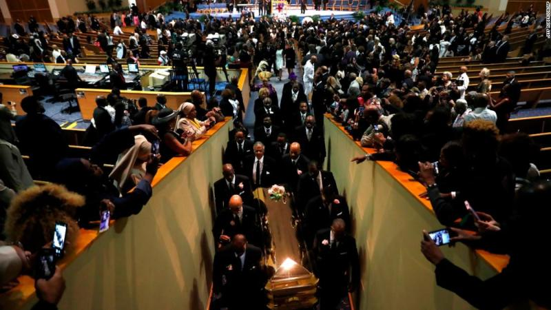 """Pallbearers carry Franklin's casket out of Greater Grace Temple at the end of her funeral service on Friday. Mourners made their way through the center of the church as Jennifer Holliday and the Aretha Franklin Celebration Choir performed Franklin's hit """"Climbing Higher Mountains."""""""