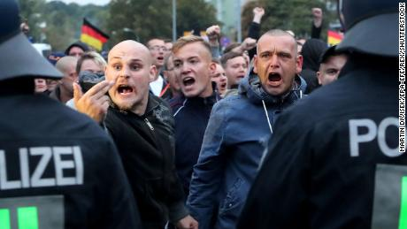 Right-wing protesters confront policemen during a demonstration in Chemnitz Saturday.
