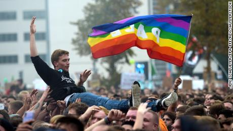 A man crowsurfs at the concert in Chemnitz on Monday.