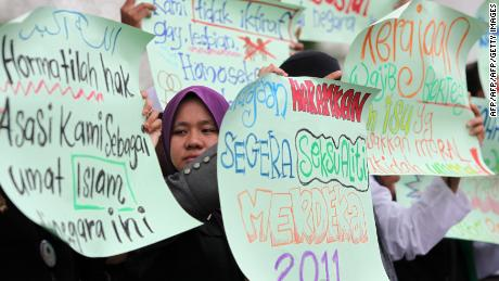 Protesters raise placards during a pro-LGBT protest in Shah Alam, near Kuala Lumpur in 2011.