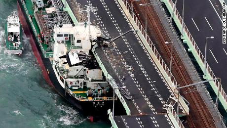 A tanker rests after slamming into the side of an Osaka bridge that connects the airport to the mainland, damaging part of the bridge and the vessel.