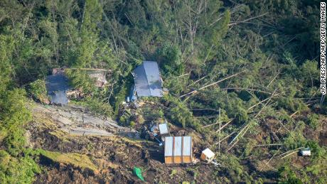 This picture shows an aerial view of houses damaged by a landslide in Atsuma, Hokkaido, on September 6, 2018, after an earthquake hit the northern Japanese island of Hokkaido.