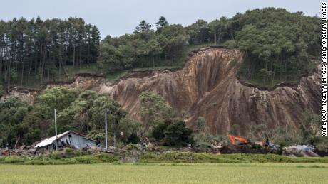 Buildings lie in ruins after being hit by a landslide caused by an earthquake, on September 7, 2018 in Atsuma.