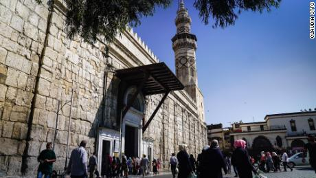A crowd gathers outside Umayyad mosque -- Islam's fourth holiest site -- in Damascus's old city.