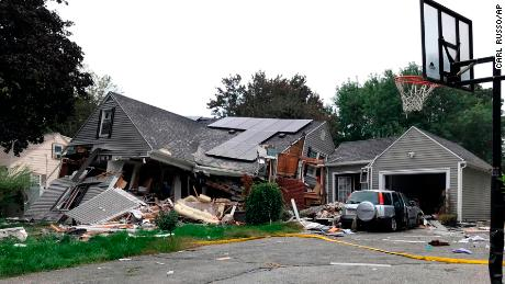 A house in Lawrence is mostly in ruins on Thursday after a series of explosions.