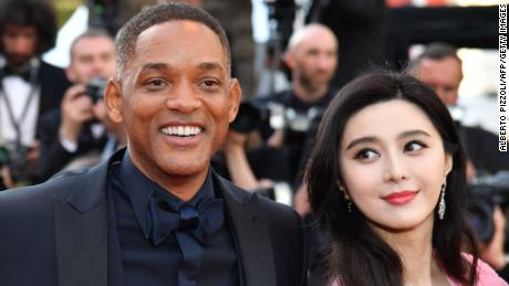 US actor Will Smith (L) and Chinese actress Fan Bingbing pose as they arrive on May 23, 2017 at the Cannes Film Festival in France.