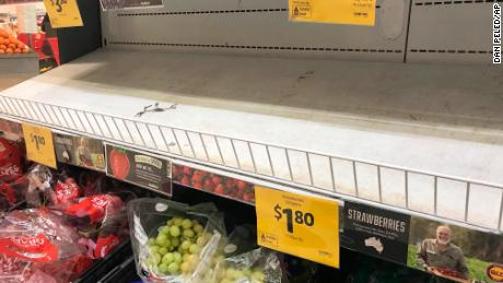 Empty shelves, normally stocked with strawberry punnets, are seen at a Coles Supermarket in Brisbane on September 14.