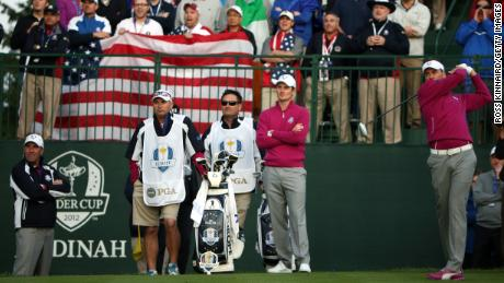Poulter (right) tees off as the crowd roars at Medinah in 2012.