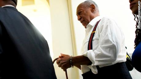Bill Cosby is taken away in handcuffs after he was sentenced to three-to-10 years for felony sexual assault on Sept. 25, 2018, in Norristown, Pa.