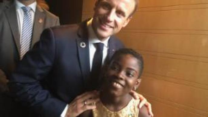 10-year-old DJ Switch backstage with French President Emmanuel Macron at the Goalkeepers 2018 event in New York.