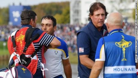 Phil Mickelson concedes the match that confirmed a European triumph.