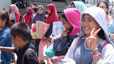 Hopeful passengers wait on the dock at Palu on Thursday, enthusiastic to board an Indonesian naval vessel which will take them away.