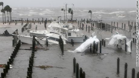 The hurricane damages boats at the Port St. Joe Marina on Wednesday.