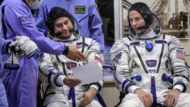 Roscosmos cosmonaut Alexei Ovchinin, left, and NASA astronaut Nick Hague ahead of their Soyuz MS-10 space flight.