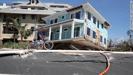 Hurricane Michael carried a home across a road and slammed it against a condo complex in Mexico Beach.