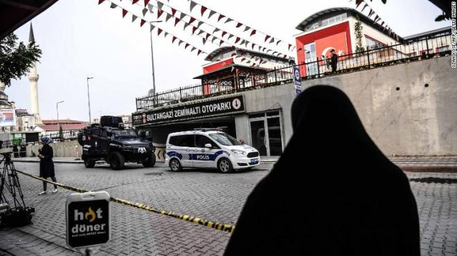 Turkish police stand guard in front of parking lot in Istanbul, where an abandoned car belonging to the Saudi consulate was found.