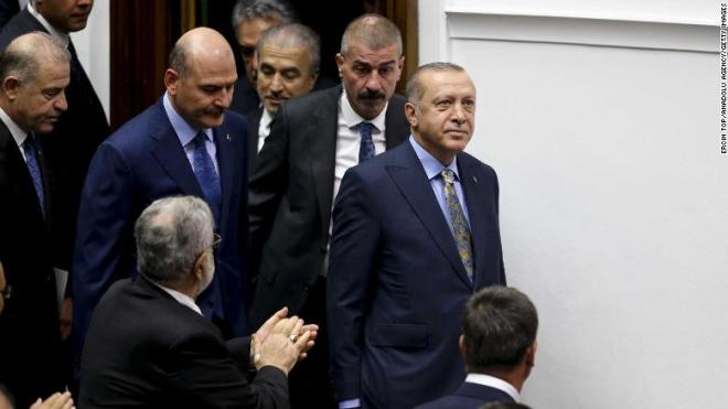 Erdogan is applauded inside the Turkish parliament in Ankara.