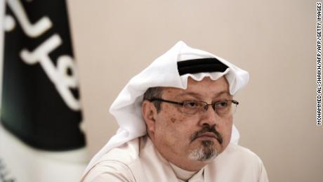 Jamal Khashoggi looks at a press conference at the Bahraini capital Manama, on December 15, 2014.
