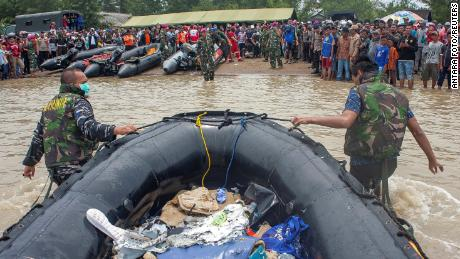 Soldiers push inflatable raft as they transport debris of the aircraft Lion Air Flight JT610, which crashed into the sea as they go on Tanjung Pakis Beach in Karawang, Indonesia.