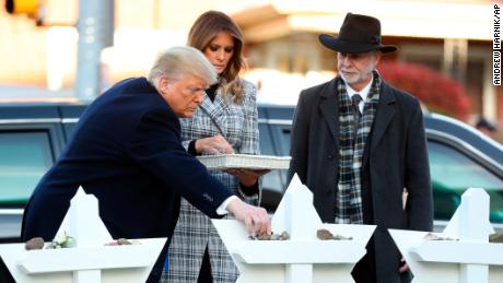 The President and first lady put down stones from the White House at a memorial for those killed in the massacre.