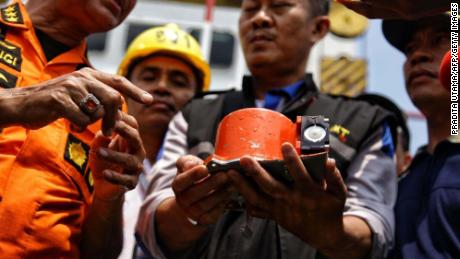 """A photo from Indonesian media agency """"detikcom"""" shows officials displaying part of the ill-fated Lion Air flight JT 610's flight data recorder, after it was recovered from the Java Sea on Thursday, November 1."""