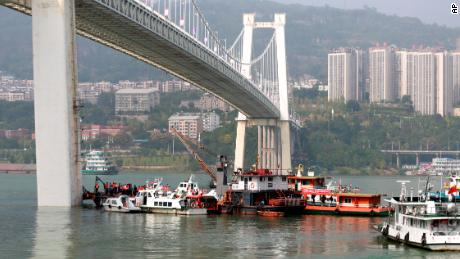 Rescuers conduct search and rescue operation at the site where a bus has plunged off a bridge into the Yangtze River in Wanzhou on October 28.