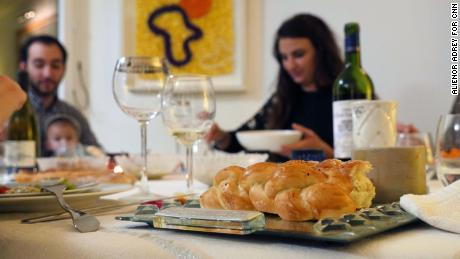 Myriam's family sit down together for Shabbat dinner in a Parisian suburb.