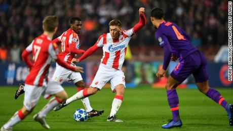 Red Star Belgrade's Milan Pavkov in the process of scoring his second against Liverpool.
