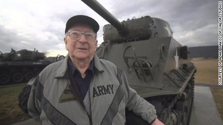 Smoyer with a US tank from World War II. German tanks had Americans outgunned, but Smoyer destroyed a feared German tank during a legendary battle.