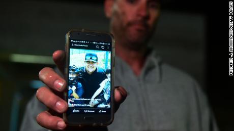 Jason Coffman shows a photo of his son, Cody Coffman.