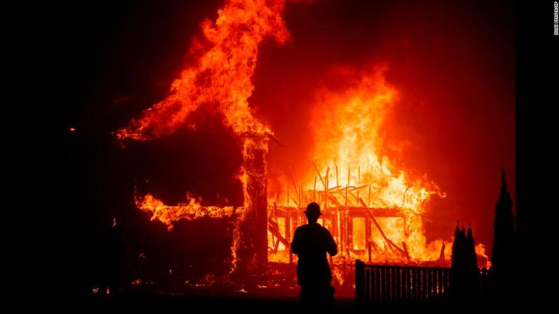 A home burns as the Camp Fire rages through Paradise.