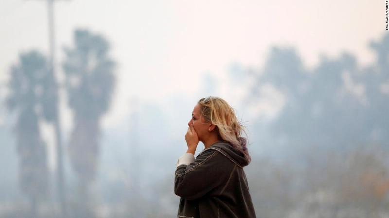 A woman reacts to devastation of the Woolsey Fire in Malibu on Friday.