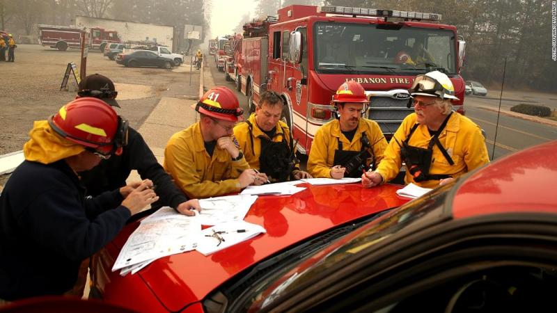 Firefighters meet in Paradise on November 10.