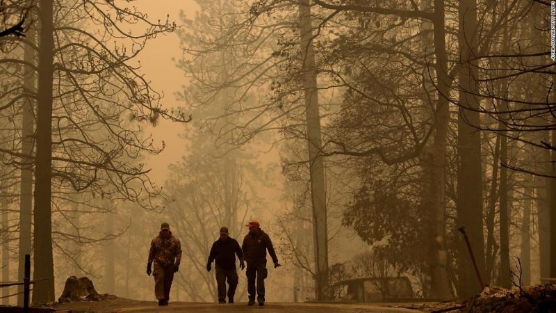 Sheriff's deputies walk through a neighborhood destroyed by the Camp Fire on November 10.