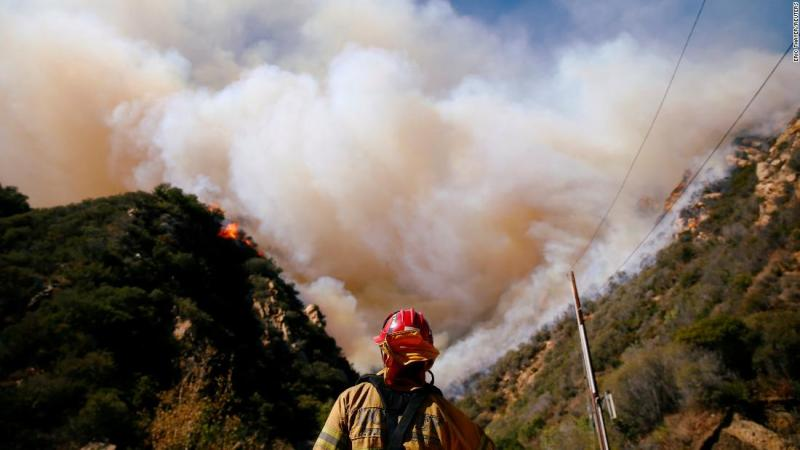 Firefighters battle the Woolsey Fire on November 11 in Malibu.