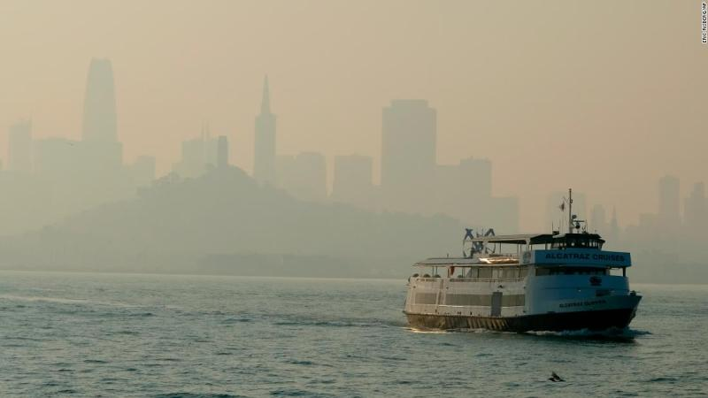 A ferry makes its way toward Alcatraz Island on November 12 as the San Francisco skyline is obscured by smoke that drifted from the Camp Fire in Butte County.