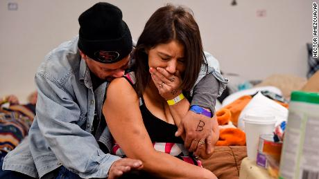 Joseph Grado embraces his wife, Susan, at a shelter this week in Chico after losing their home to fire.