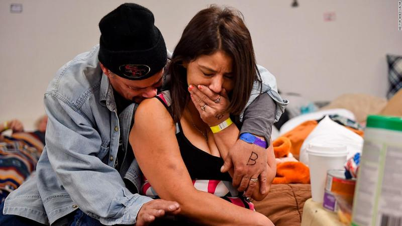 Joseph Grado and his wife, Susan Grado, embrace while staying at a shelter for fire victims on November 12 in Chico, California. The Camp Fire destroyed their home in the city of Paradise.