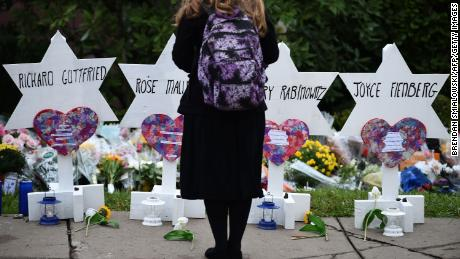 A woman mourns at a memorial outside the Tree of Life synagogue in Pittsburgh.