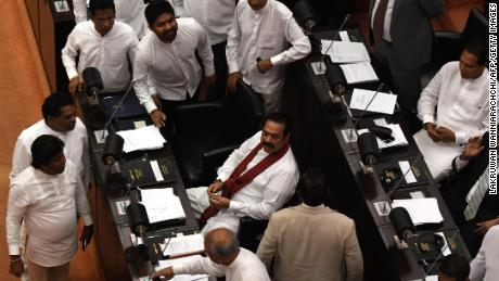 Sri Lanka's former president and newly appointed prime minister Mahinda Rajapakse (C) attends the parliament session in Colombo on November 14, 2018.