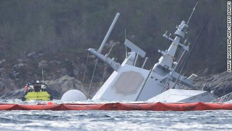 The KNM Helge Ingstad pictured on November 10, 2018 in the Hjeltefjord near Bergen. The frigate, which was returning from NATO's Trident Juncture exercises, was evacuated after the collision with the Sola TS tanker, Norway's army said.