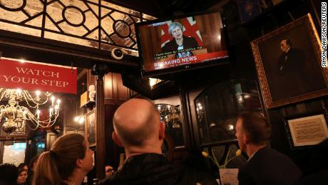 Pubgoers in London watch a broadcast of Theresa May's press conference