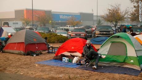 Fire drove them out of their homes. Now they could be flooded out of their tent city.