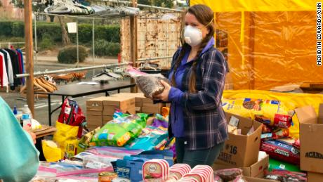 Volunteers provide evacuees with supplies from smoke masks to food.