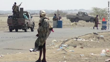 Yemeni pro-government forces gather at a checkpoint in a street on the eastern outskirts of Hodeidah.