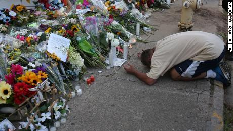 A man prays at a memorial to the Charleston victims.