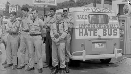 """George Lincoln Rockwell, center, leader of the American Nazi Party, with followers and his """"hate bus"""" in  Alabama in 1961."""