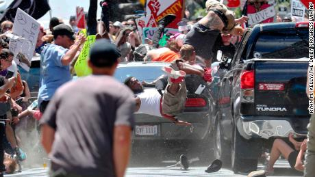 People are flung into the air as a car drives into a crowd demonstrating against the white nationalist rally in Charlottesville.